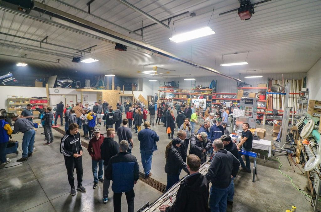 Kellermeier's community news section. A large group of teens and tradeworkers at a skilled trades night.