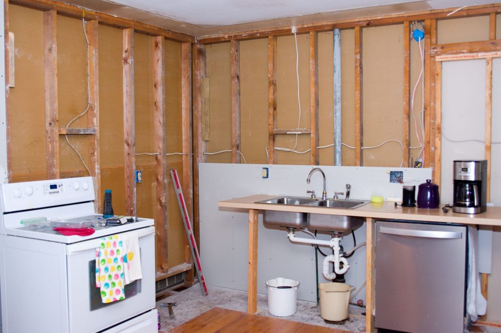 The exposed kitchen plumbing during a remodel before drywall and tile covers it.