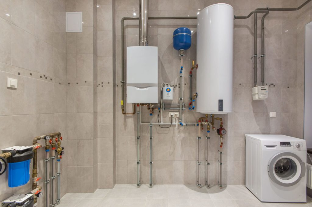 Learn how to increase home value by upgrading its plumbing. New water heater and filtration system in a home's basement.