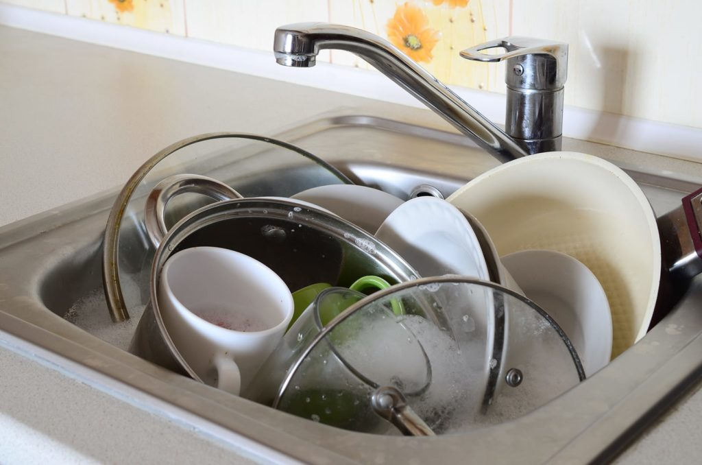 Too many dishes and soaps and food waste can cause a bad smelling drain, no matter how clean your dishes become.