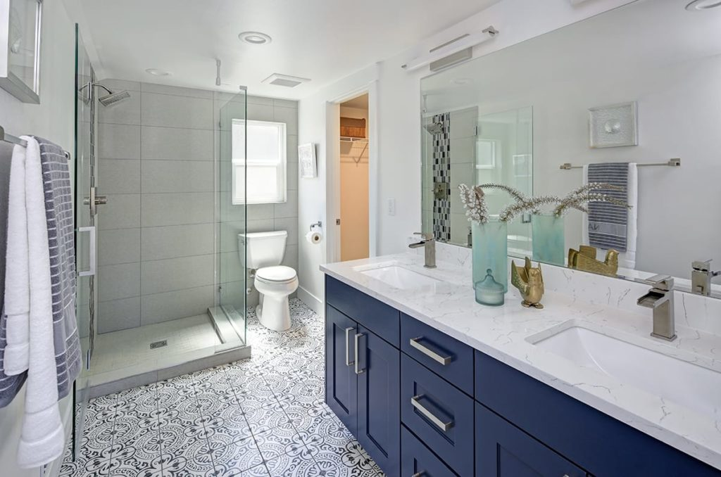 Some bathroom remodel ideas call for not including a bathtub, like this upscale bathroom with a floor to ceiling shower basin.