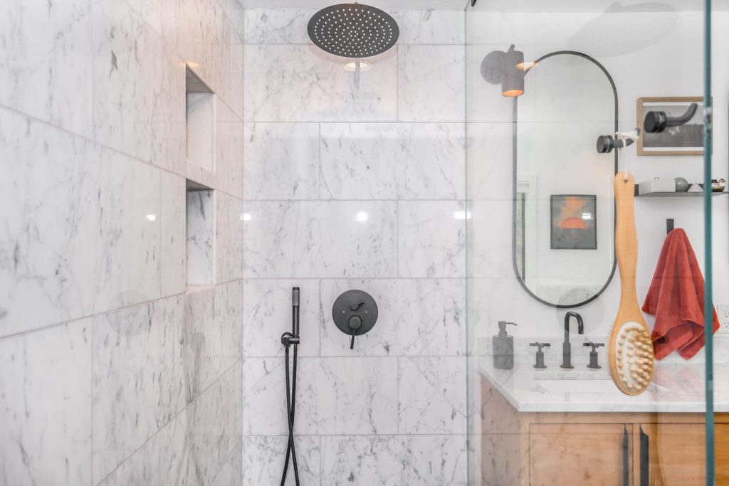 A shower head for low water pressure may the the solution you pressure issues. An updated bathroom with top and side shower heads.